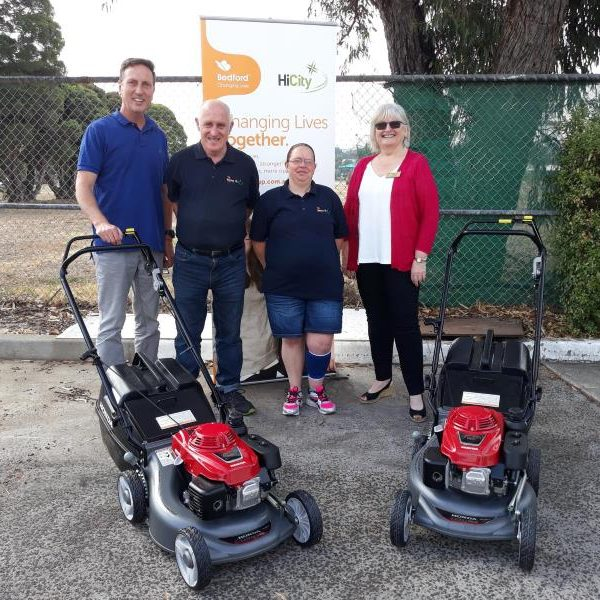 Glenda Coswello & Addrian Pilati with HiCity workers for mowers presentation4a